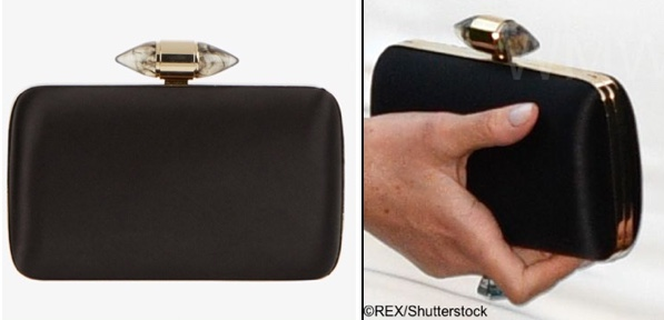 d269d689bd Meghan brought back her Givenchy Clutch with Jewelry Clasp ( 1990). The  minaudière is done in black satin