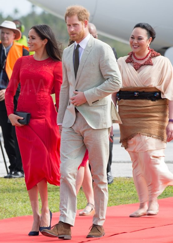 e8685b5e312a Meghan is Radiant in Red for Tonga Arrival. Meghan looked radiant in a red  Self-Portrait dress ...