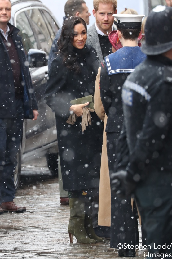 43014e99a339 Meghan wore a mix of designers for today s snowy visit to Bristol with  Prince Harry.